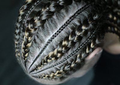 corn-rows-braiding-young girl